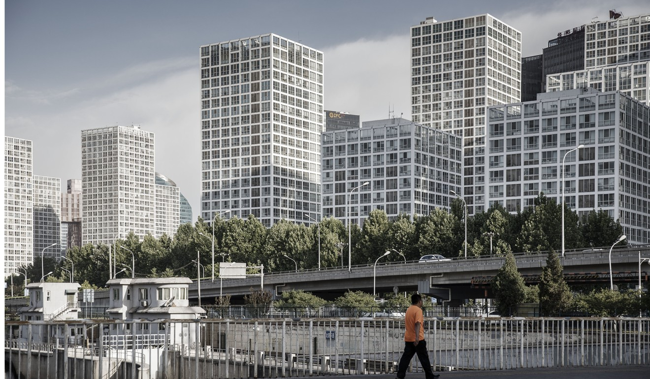 Why Are Middle Class Chinese Moving Their Money Abroad This Week Wiring China A Pedestrian Near Jianwai Soho Mixed Use Residential And Commercial Complex In Beijing Many Worried Chinas Real Estate Market Could