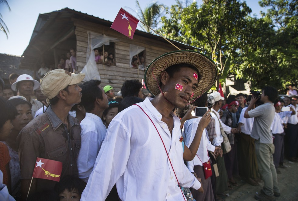 Members of the Rakhine ethnic minority queue to catch a glimpse of Suu Kyi, in Taunggok, Rakhine state, in October 2015. Picture: Ann Wang
