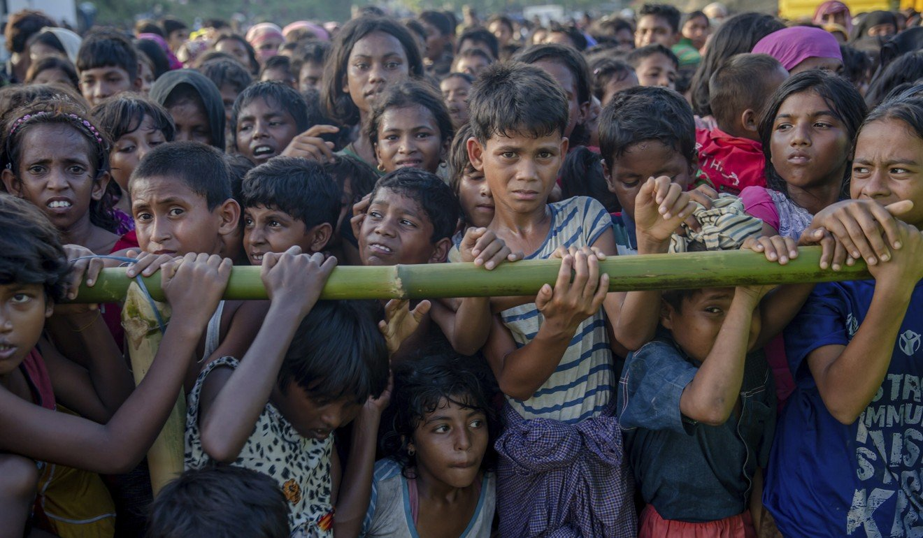 Rohingya Muslim children, who crossed over from Myanmar into Bangladesh, wait to receive aid during a distribution near Balukhali refugee camp, on September 25. Picture: AP