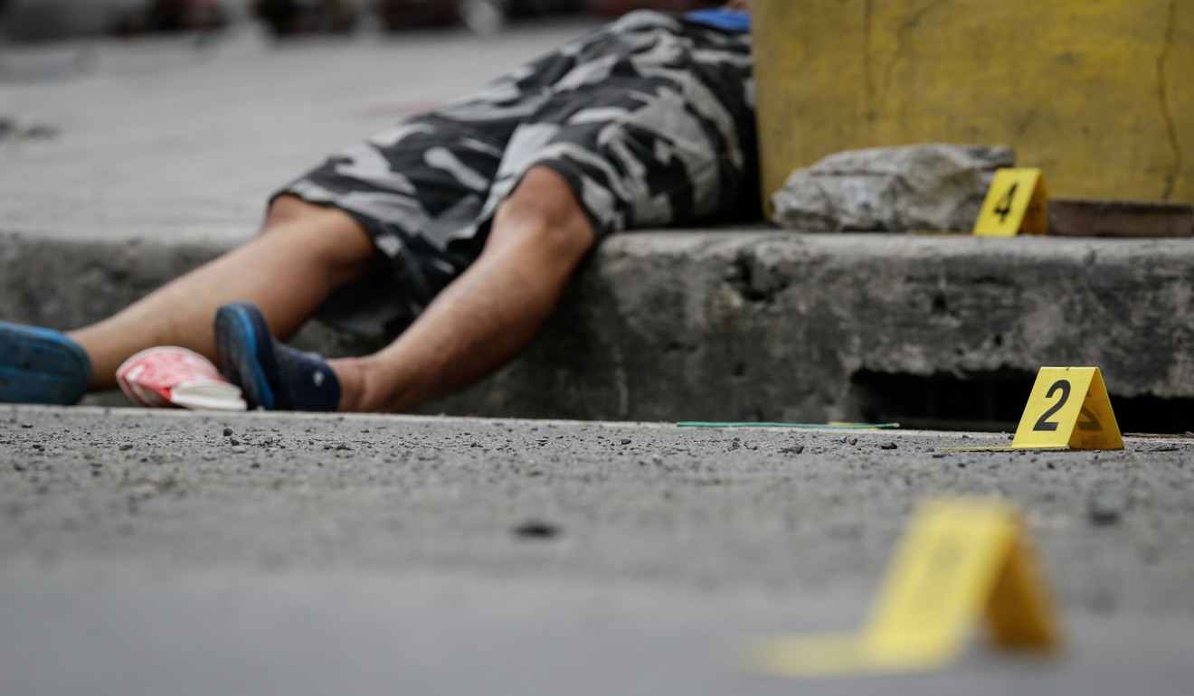 The body of a man who was shot by unidentified gunmen on a motorcycle south of Manila earlier this month. It was one of many deaths associated with Philippine President Rodrigo Duterte's drug war.