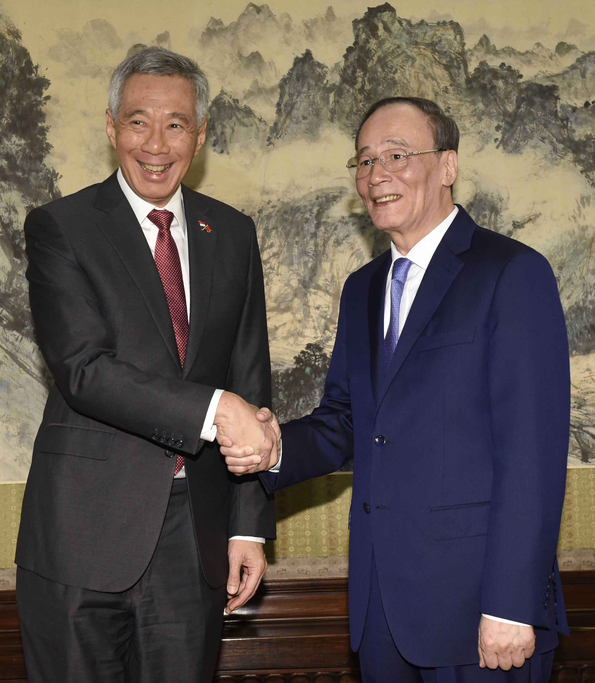 Chinas vice president wang qishan given key foreign policy role chinas vice president wang qishan right shakes hands with singapores prime minister lee hsien loong before a meeting in beijing last month photo kyodo stopboris Gallery