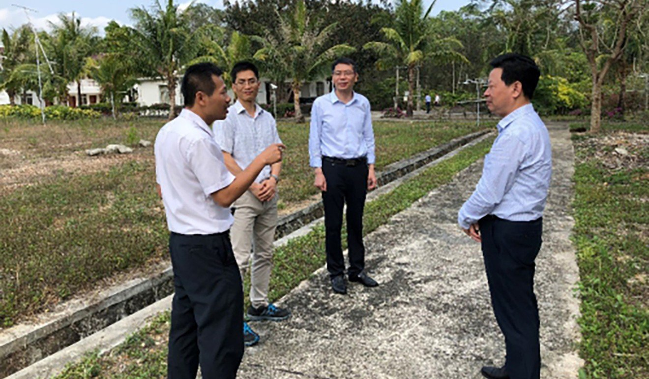 Li Shushen and other officials from the Chinese Academy of Sciences pictured on a visit to the site in Hainan. Photo: Handout