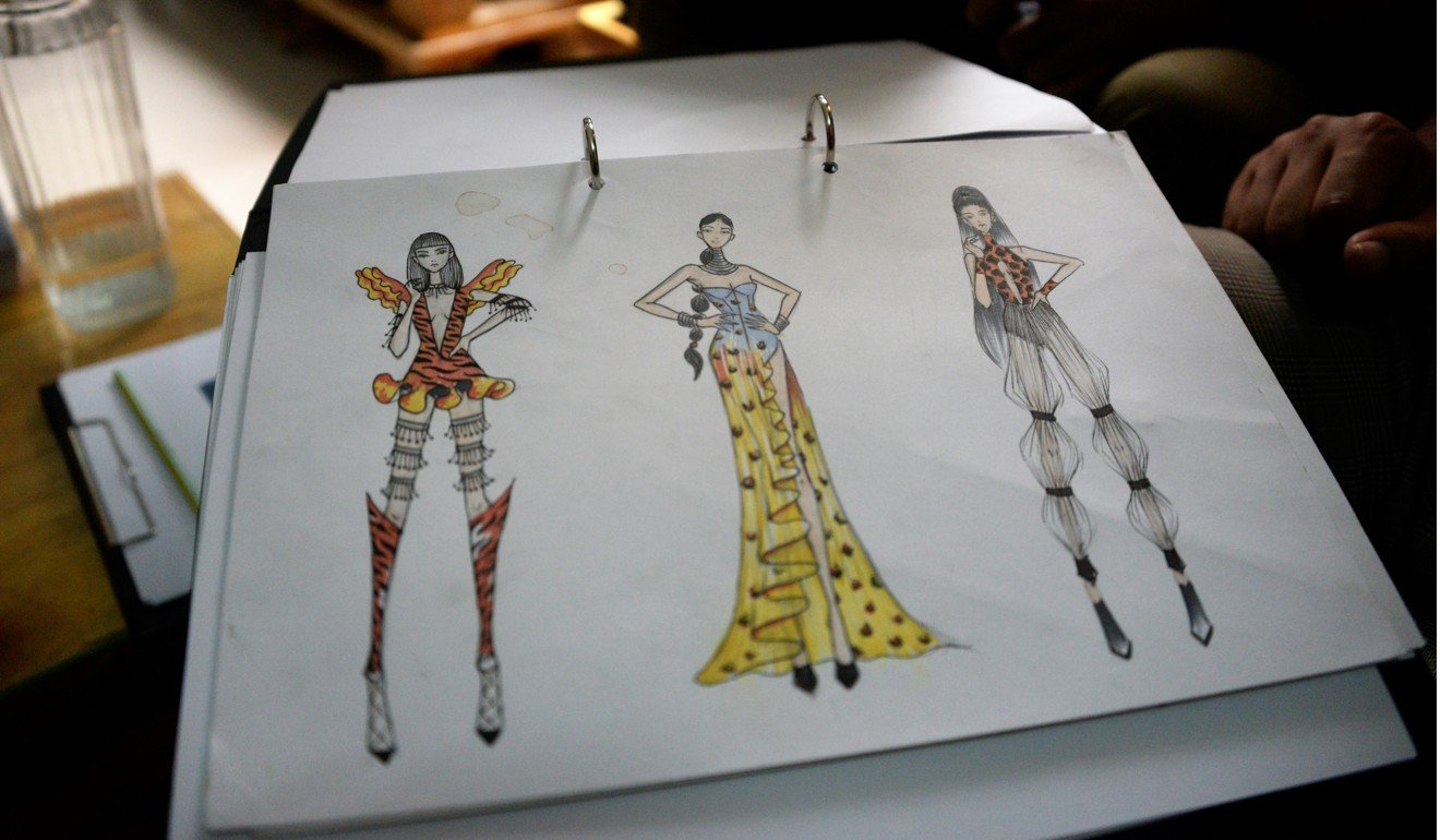 Sketches by La Chhouk of dresses that represent the Indochinese tiger facing extinction. Photo: Didem Tali cambodian designers turning trash and recyclables into high fashion Cambodian Designers Turning Trash and Recyclables into High Fashion 4bb9d5b4 af31 11e8 b224 884456d4cde1 1320x770 122041