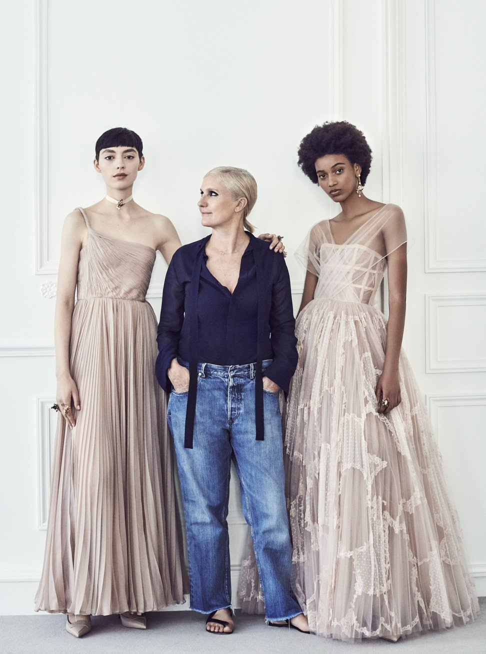 796cdf5fca44 Dior s artistic director Maria Grazia Chiuri with models featuring some of  her more feminine gowns
