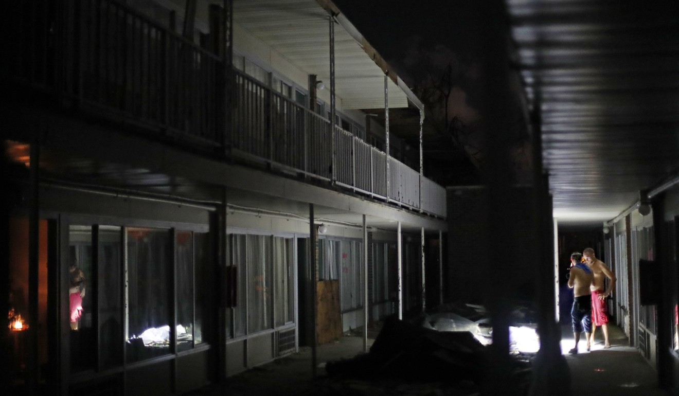 Hurricane Michael Powerless Victims In Florida Are Being Targeted Jet Shower Onda Chrome Residents Use Torches To Navigate The Dark Walkways At Night Damaged American Quality Lodge After Panama City On October 16