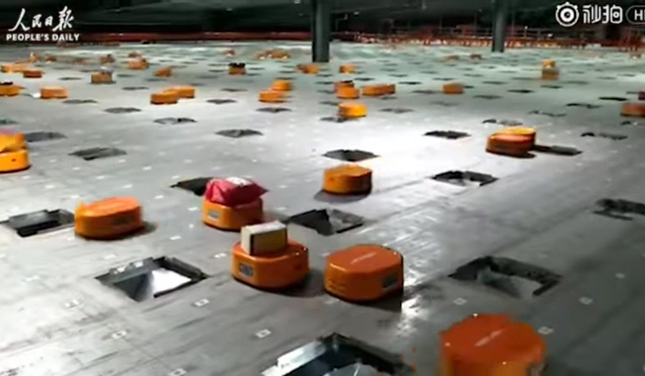 An army of orange Hikvision robots in the sorting centre of China's Shentong (STO) Express delivery warehouse in Hangzhou, Zhejiang province. Photo: Handout