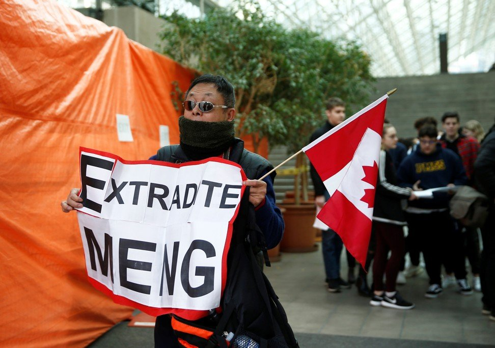 Max Wang, an immigrant from China, holds a placard calling for Canada to extradite Meng Wanzhou. Photo: Reuters