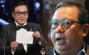 Hong Kong Film Awards Association chairman Derek Yee (left) announcing that 'Ten Years' won the Best Film award, a decision criticised by Media Asia chairman Peter Lam (right). Photo: AP, Edmond So