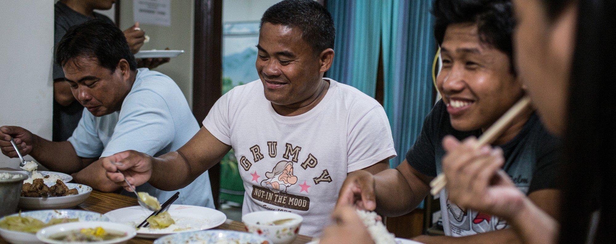 Filipino fishermen at a shelter after facing abuse in Taiwan.