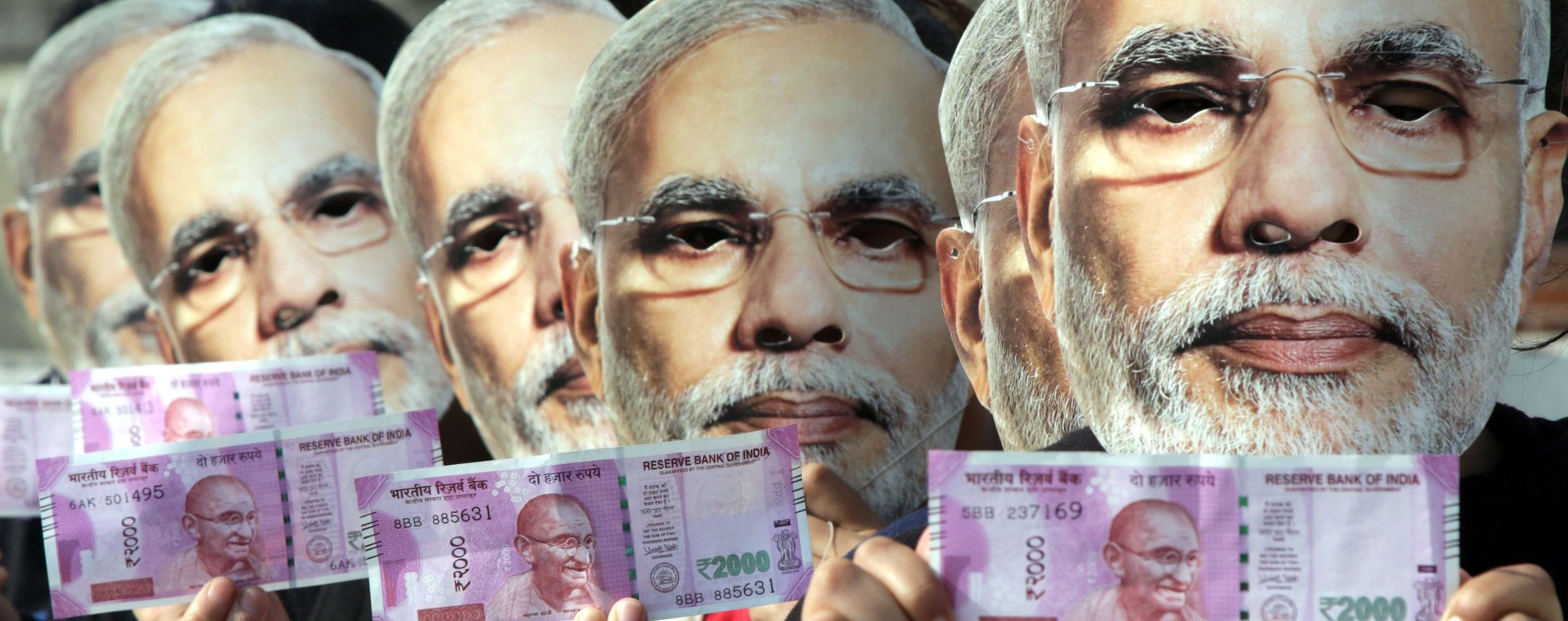 Indias Note Ban What Modi Can Really Achieve This Week In Asia Wiring Money China Epaselect Epa05650763 Indian Girls Wearing Masks Depicting Prime Minister Narendra Hold New