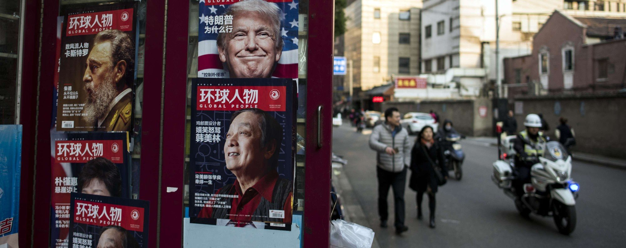 "This picture taken on December 14, 2016 shows a advertisement for a magazine (top R) featuring US President-elect Donald Trump on the cover at a news stand in Shanghai. China said on December 17 it would return a US naval probe seized in international waters, as it slammed the ""hyping"" of the incident as ""inappropriate and unhelpful"". The incident comes amid escalating tensions between China and the United States, with Trump repeatedly infuriating Beijing by questioning longstanding US policy on Taiwan, calling Beijing a currency manipulator and threatening Chinese imports with punitive tariffs. / AFP PHOTO / Johannes EISELE"