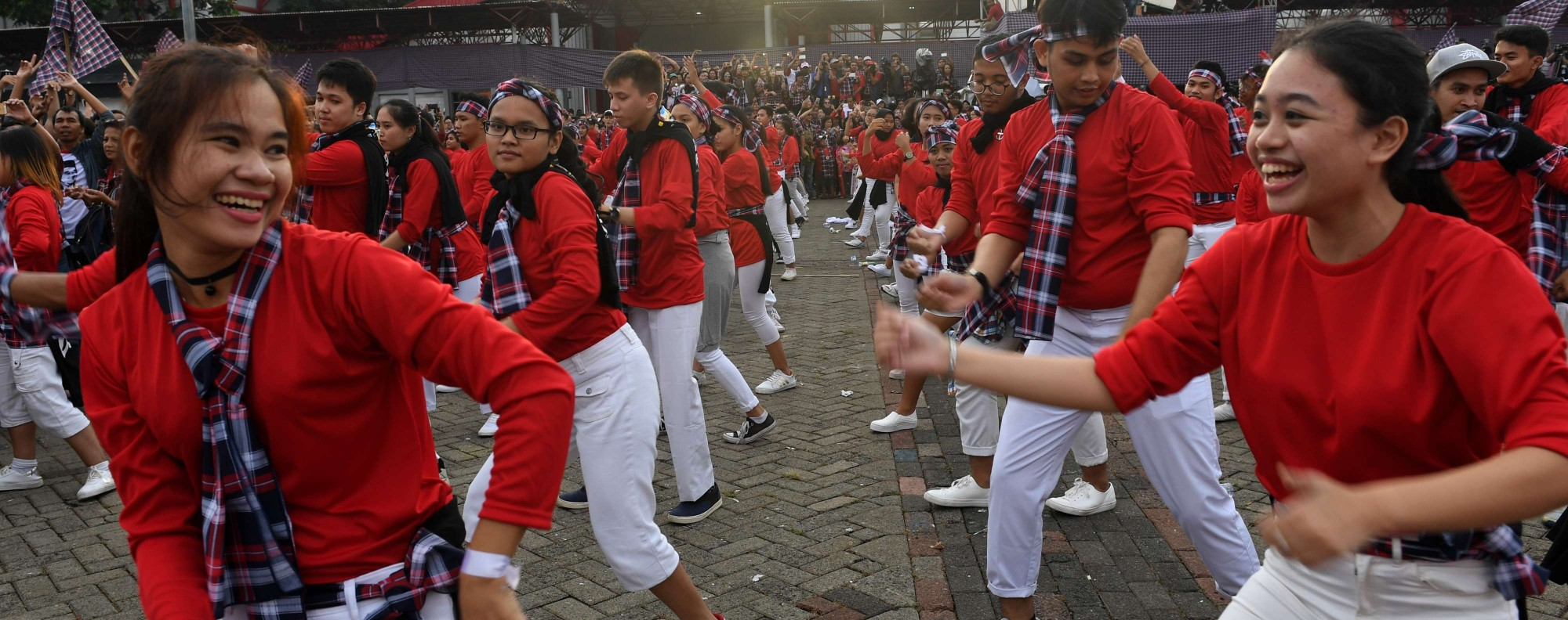 Dancers perform at an Ahok campaign rally. Photo: AFP