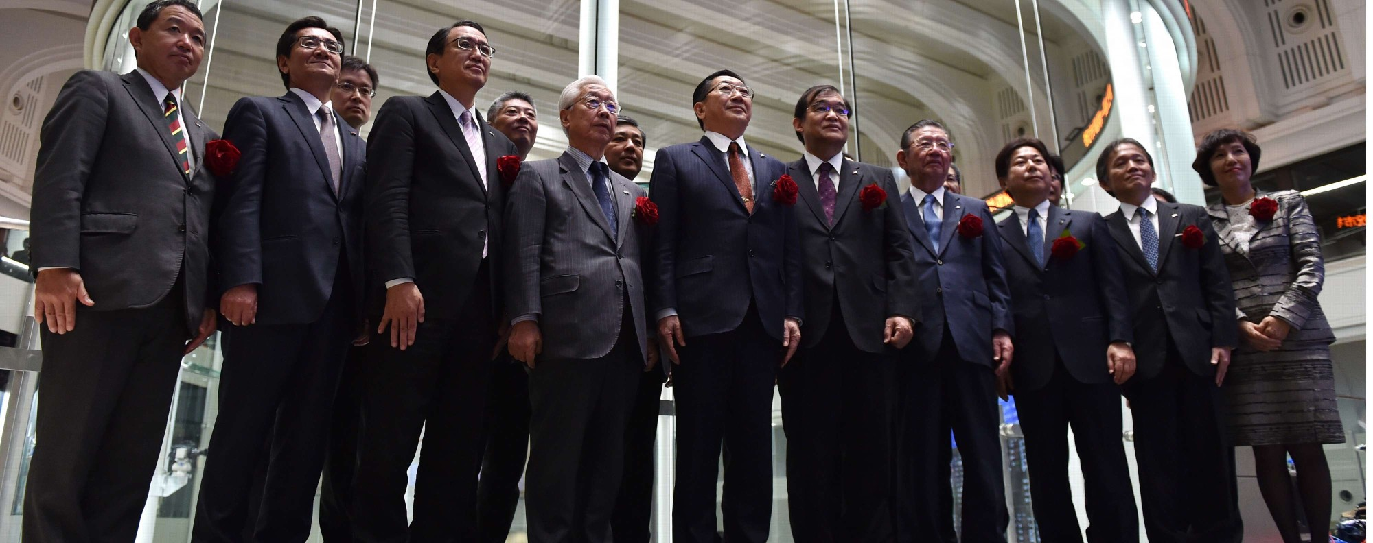 JR Kyushu officials at the company's listing. Photo: AFP