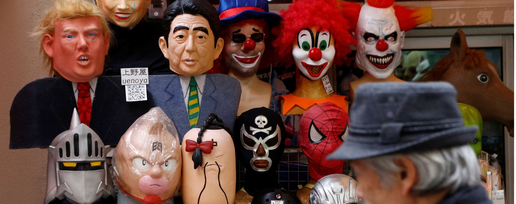 Masks of world leaders including Japan's Shinzo Abe in Tokyo. Photo: Reuters