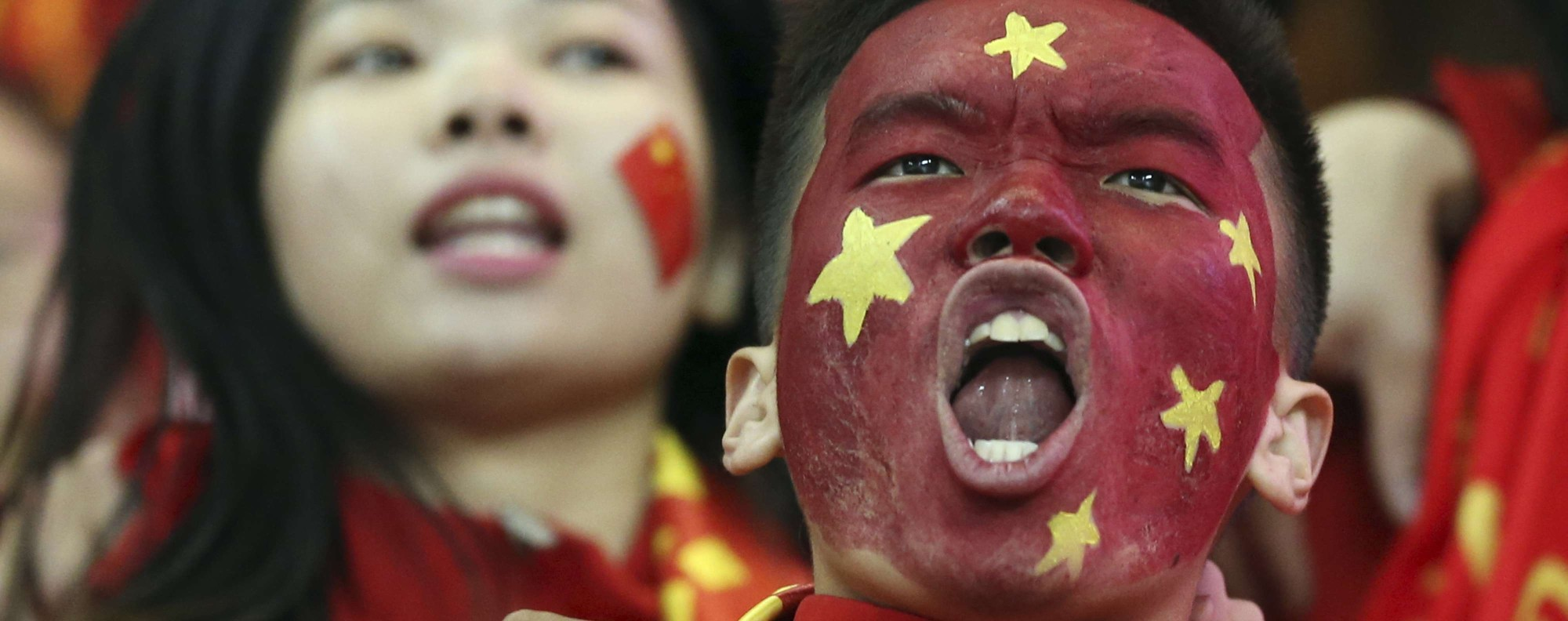 Chinese fans celebrate their 1-0 win over South Korea. Photo: AP