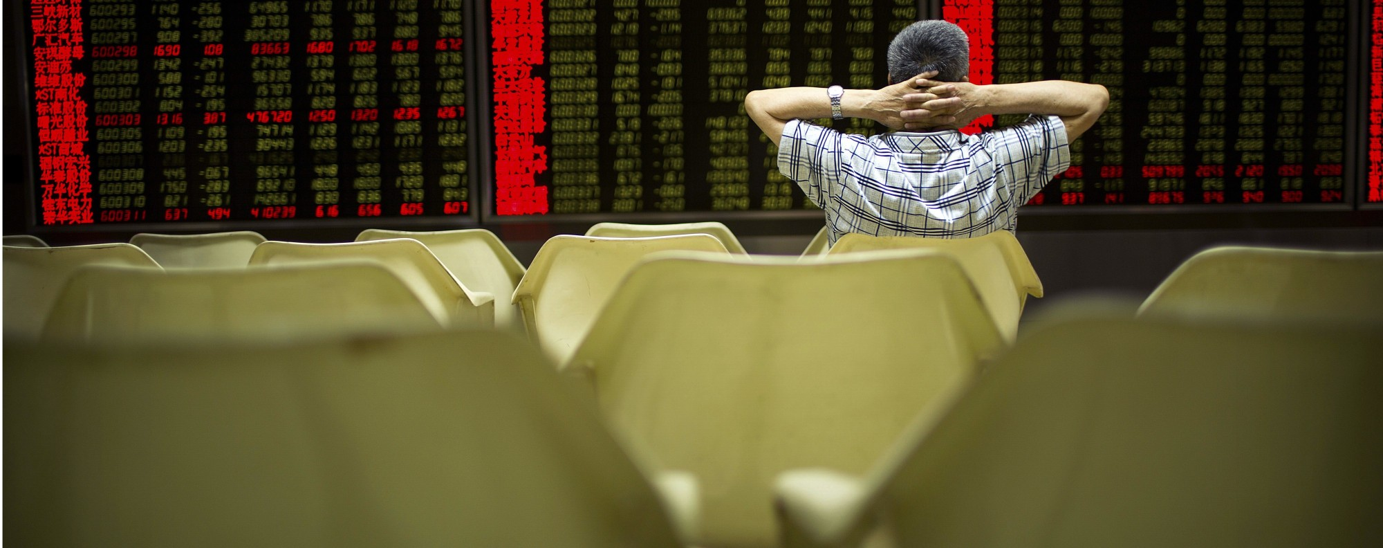 An investor monitors stock prices in Beijing. Photo: AP