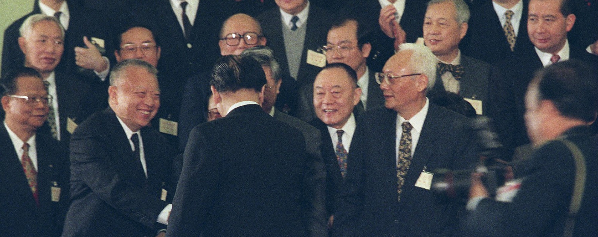 Tung Chee-hwa shakes hands with Jiang Zemin, in Beijing, in 1996. Picture: SCMP