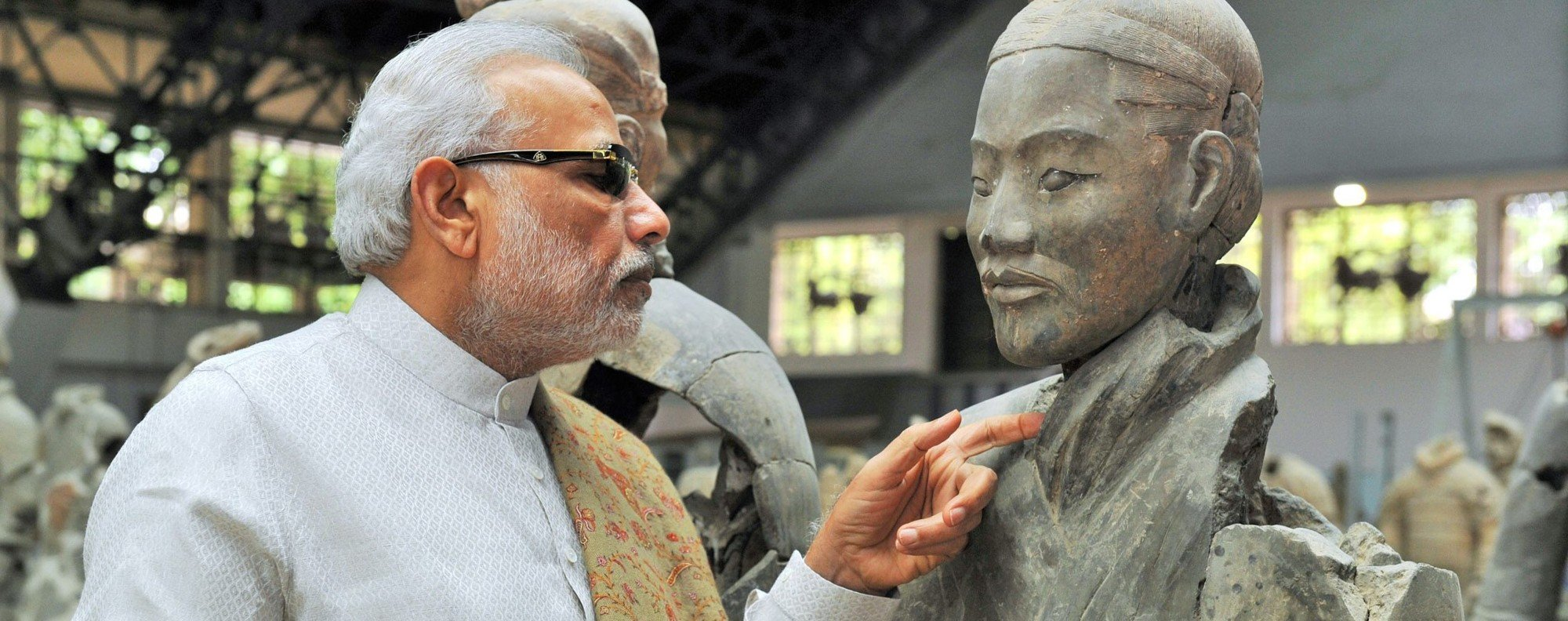India's Prime Minister Narendra Modi looking at a terracotta warrior in Xian. Photo: EPA