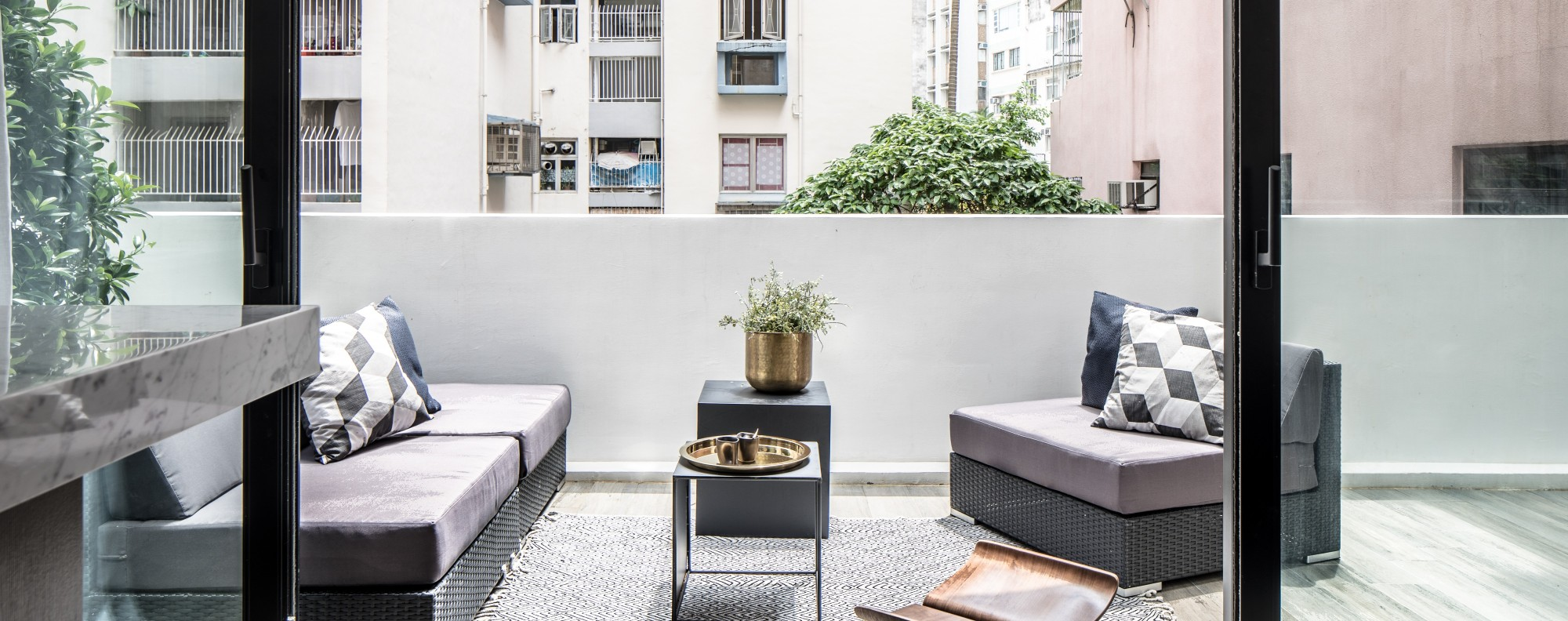 Small hong kong flat with a 600 sq ft terrace shows how to for Interior design 600 sq ft flat