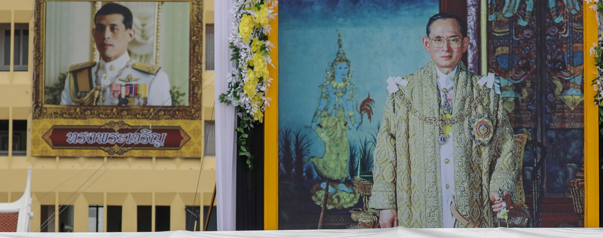 Paintings of King Vajiralongkorn and his father. Photo: Reuters