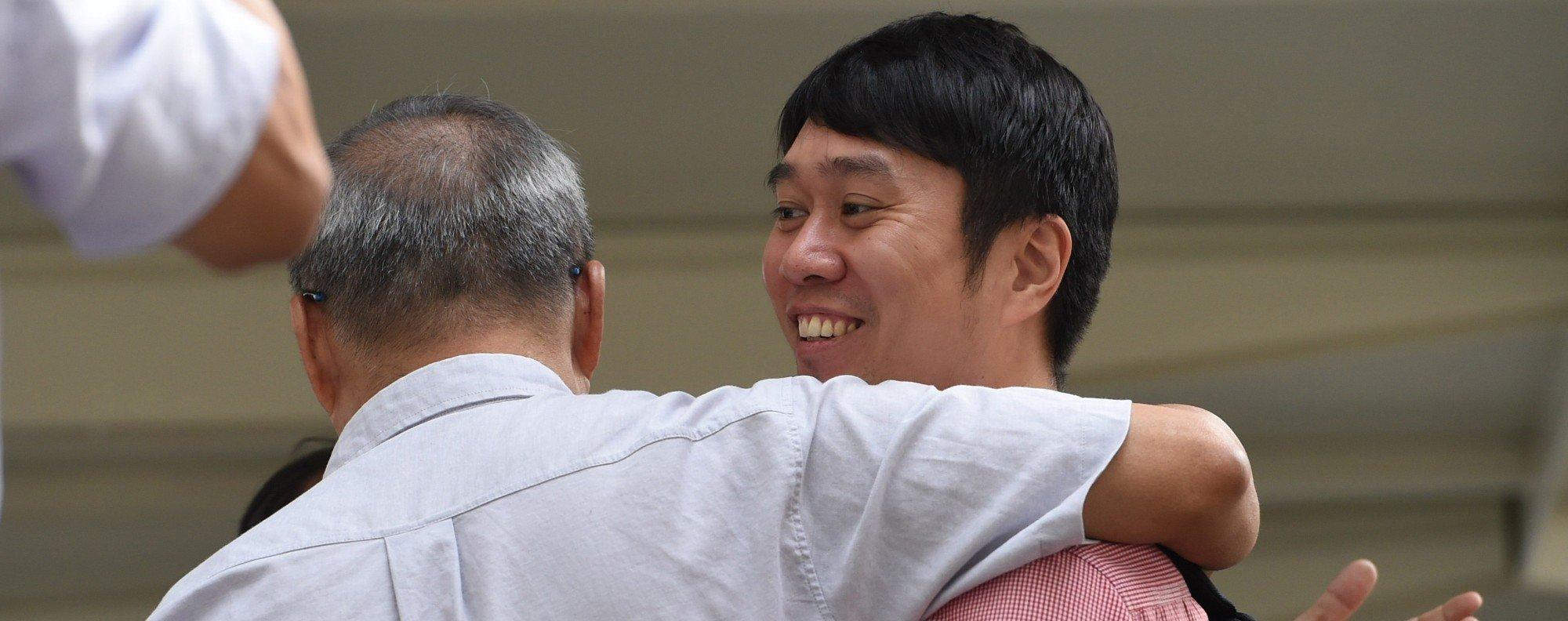 Jolovan Wham outside court. Photo: AFP