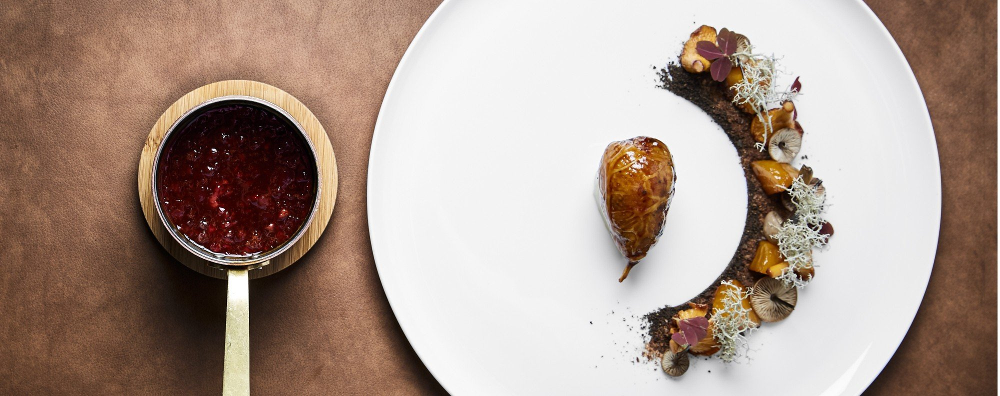 A quail dish served with yellow beets and moss with burned herbs and potatoes from Gastromé. Photo: Stoy Munkholm