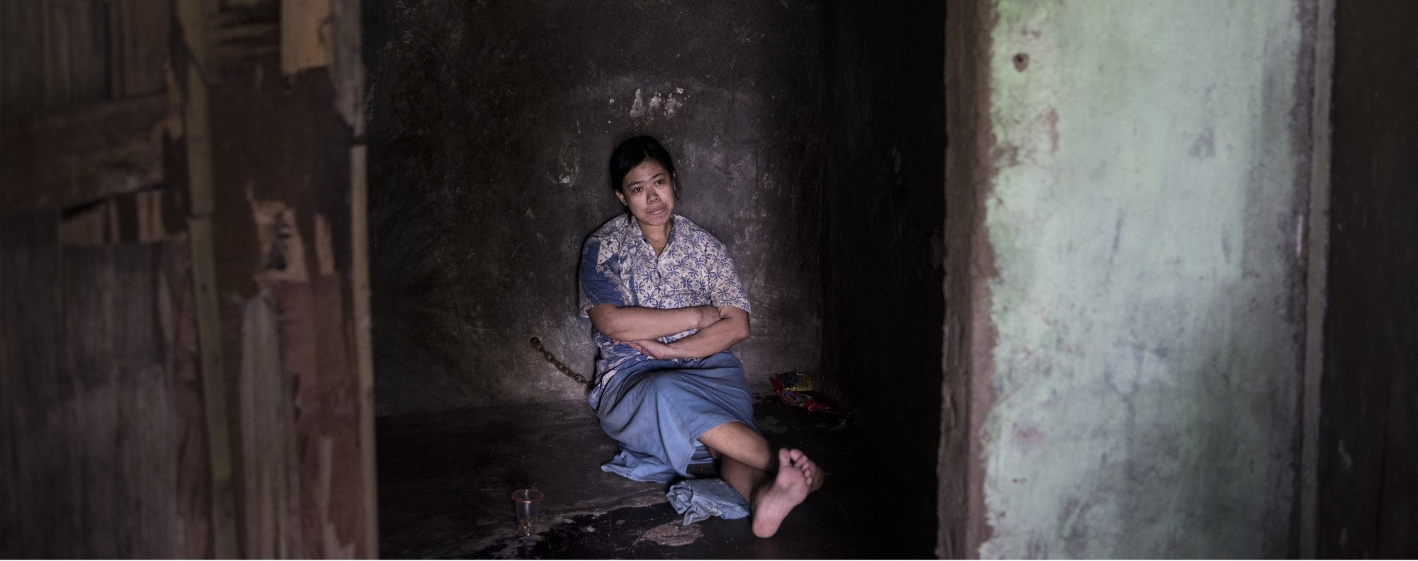 Ernawati is chained to a wall in her house in Indonesia. Picture: Miguel Candela