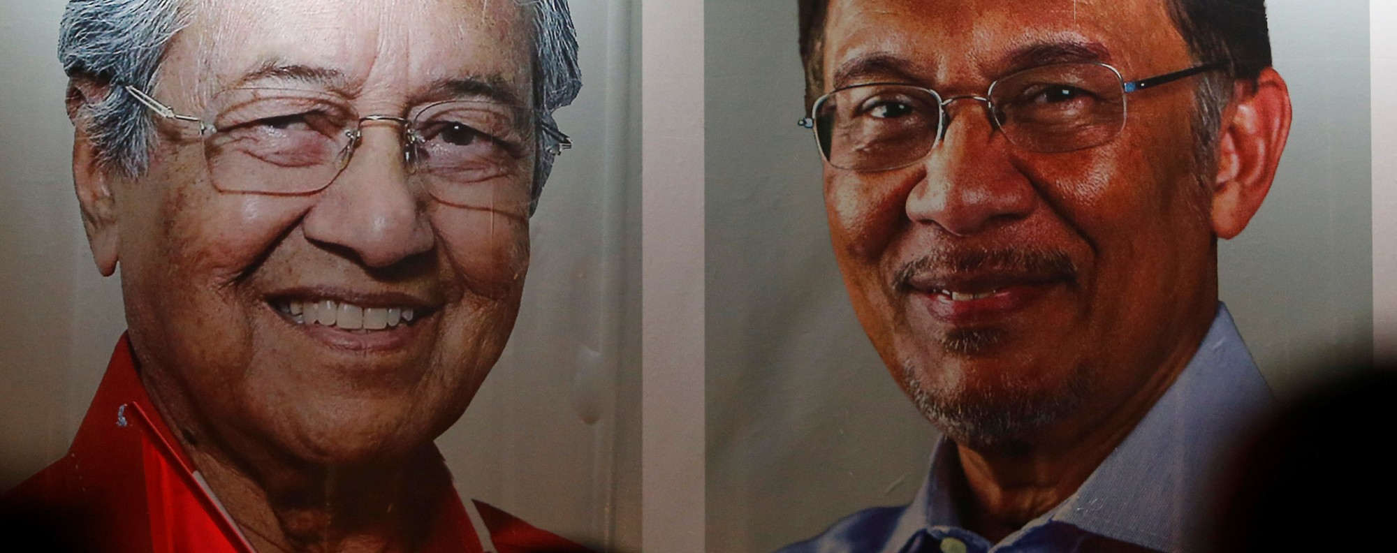 Posters of Mahathir Mohammad and Anwar Ibrahim in Kuala Lumpur. Photo: Reuters