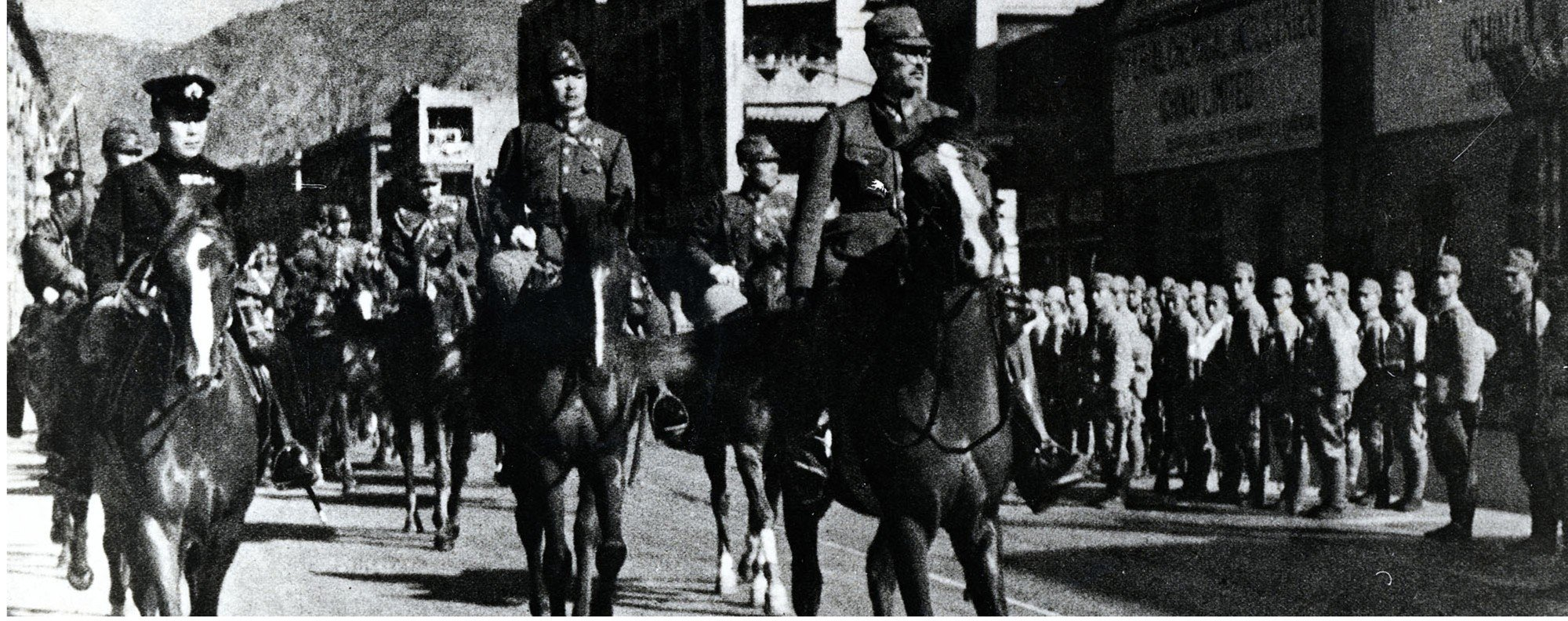Japanese General Takashi Sakai (right) rides into Hong Kong in 1941. Picture: Getty