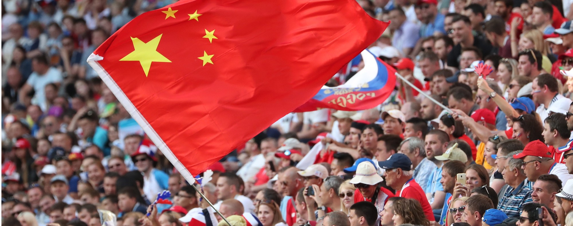 Fan waves the flag of China at the World Cup. Photo: EPA