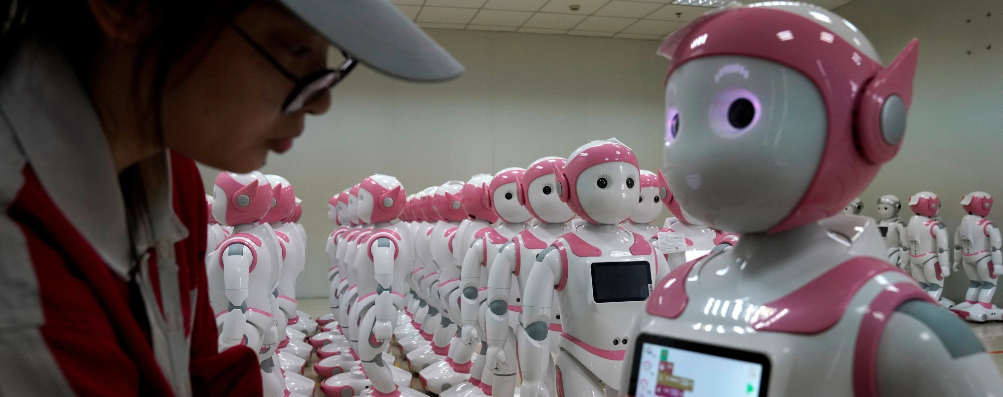 A worker puts finishing touches to a robot. Photo: Reuters