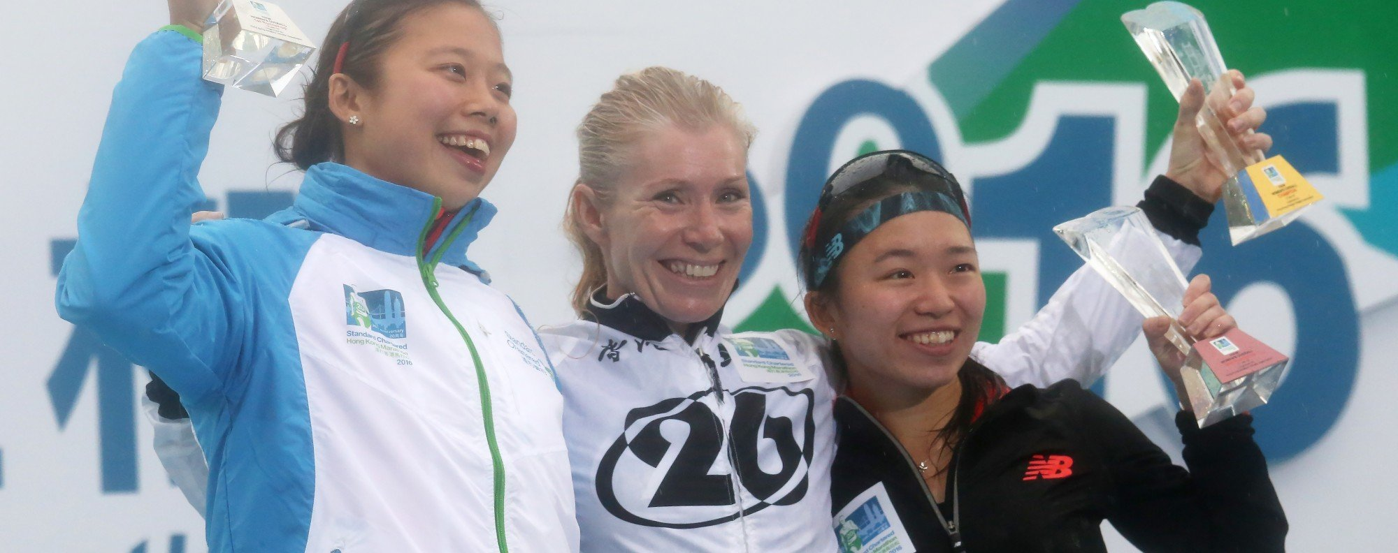 Kate Rutherford (centre) won the women's 10km Challenge at the 2016 Hong Kong Marathon – she is a triathlon coach who wants to create a pathway for more women to follow her. Photo: Nora Tam