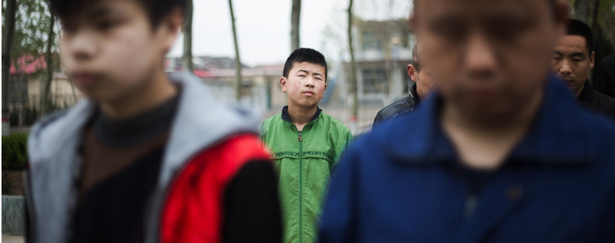 Sixteen-year-old Shungze (centre), a student at the Mu Mengjie School for the Blind. Picture: Nathan Gibson