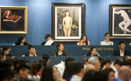 Bidding at the Poly 2012 Spring Art Auction in Beijing. Beijing Poly International Auction is the third-biggest auction house in the world, after Christie's and Sotheby's. Photo: AFP