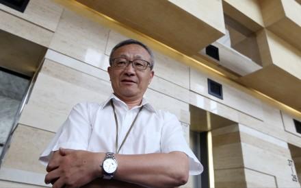 Chinachem Group Chairman Kung Yan-sum, the younger brother of Nina Wang Kung Yu-sum, speaks to the media at Nina Tower in Tsuen Wan. Photo: Sam Tsang