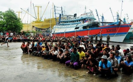Hundreds of fishermen, mostly from Myanmar and Thailand, who were rescued from a remote Indonesian island in April after they were found to be working in slavery-like conditions for Thai fishing company Pusaka Benjina Resources. Photos: AFP; Sikarin Thanachaiary