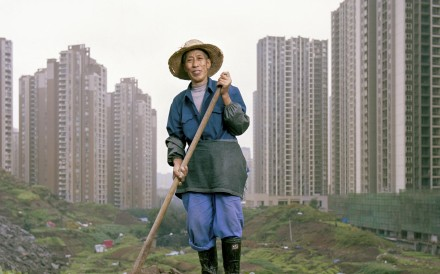 Ren Yidi, who lost his farmland to urbanisation, was compensated with two apartments in a high-rise in Chongqing. With no other means to provide for himself and his family, he has taken up farming on land around the tower block. All images and copyright: Tim Franco