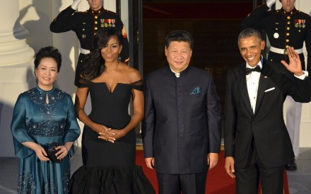 US President Barack Obama and first lady Michelle Obama pose with Chinese President Xi Jinping and his wife Peng Liyuan as they arrive for a state dinner at the White House in Washington on Friday. Photo: Reuters