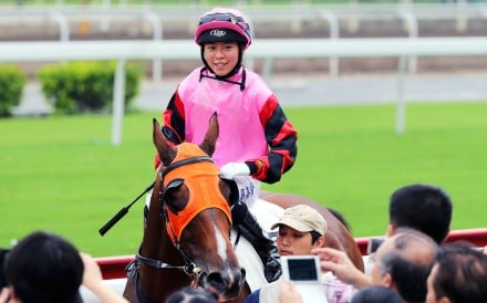 Kei Chiong returns to the cheers of the Sha Tin crowd after recording her first winner on Hearts Keeper. Photo: Kenneth Chan