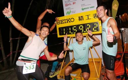 Team 2XU UFO (from left) Lam Shing-yip, Tsang Chun-kit (behind Lam), Law Chor-kin and Tang Sun-kam pose for a picture at the finish of Oxfam Trailwalker at Po Leung Kuk Jockey Club Tai Tong Holiday Camp. Photo: Edward Wong