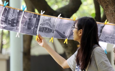 Residents pin up old photos of the area in Cadogan Street Temporary Garden as part of their battle to retain the green space. Photos: Fionnuala McHugh; SCMP