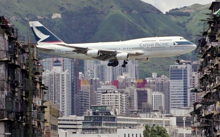 A Cathay Pacific 747 flies over Kowloon. Picture: Daryl Chapman