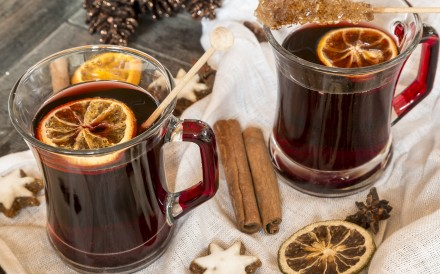 29 Oct 2014 --- Glasses of mulled wine, orange slices and cinnamon stars on cloth and wooden tray --- Image by © Sandra Roesch/Westend61/Corbis [18DECEMBER2015 FEATURES FOOD & WINE DRINK]