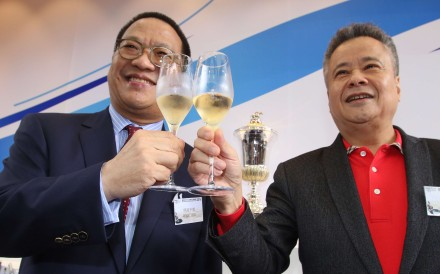 Werther's owner Johnson Chen clinks champagne glasses with Sun Jewellery's owner Tung Moon-fai during Thursday's barrier draw for the BMW Hong Kong Derby. Photos: Kenneth Chan