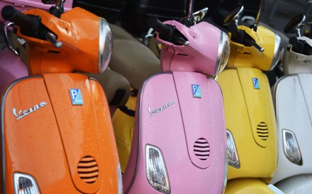Vespa scooters of different colours. Photo: AFP