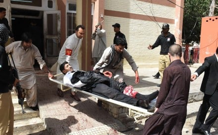 Pakistani volunteers use a stretcher to move an injured lawyer after the suicide bomb in Quetta. The regional arm of Islamic State claimed responsibility for the attack. Photo: AFP