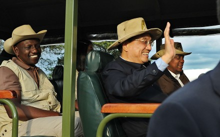Chinese Prime Minister Li Keqiang rides in a customised game-viewing vehicle with Kenyan President, Uhuru Kenyatta, right, and his vice-President, William Ruto in May 2014 at the Nairobi national park. Kenya secured a loan to build the SGR line during the visit. Photo: AFP