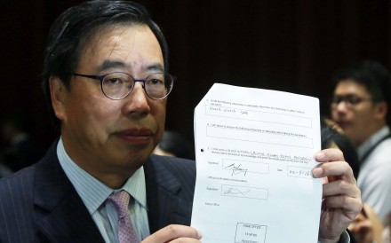 Andrew Leung Kwan-yuen presenting a stamped certificate from the UK Home Office confirming he had renounced his British nationality. Photo: Sam Tsang