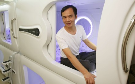 Landlord Sandy Wong in one of his capsules in a Sai Ying Pun apartment. Photos: Edward Wong