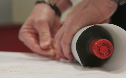 A recorked bottle of Penfolds wine being wrapped at a Penfolds recorking night in the US.